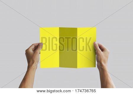 Hand Holding Blank Brochure Booklet In The Hand. Leaflet Presentation. Pamphlet Hand Man. Man Show O