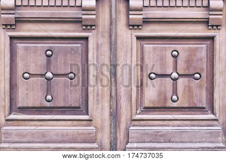 Old scratchy wooden doors with the carving
