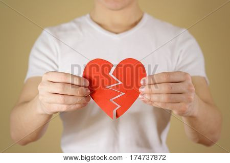 Man Hands Holding Broken Blank Empty Red Valentines Card With Heart On A White Background