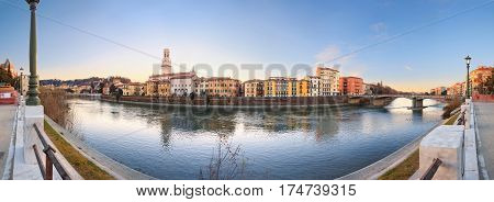 historical quarter of Verona, panorama from river on Duomo Cathedral at sunrise