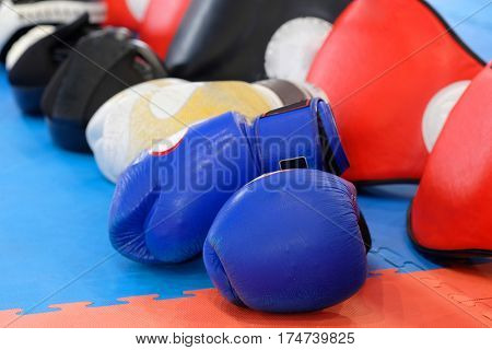 Boxing gloves and other boxing equipment close up