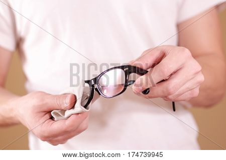 Man Hand Cleaning Glasses Lens With Isolated Background