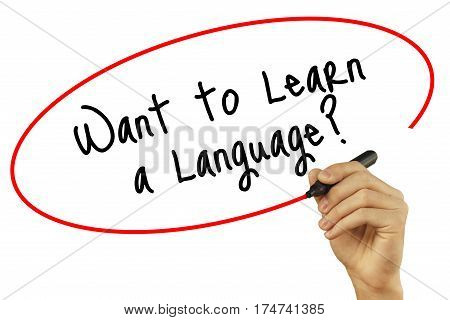 Man Hand Writing Want To Learn A Language? With Black Marker On Visual Screen. Isolated On Backgroun