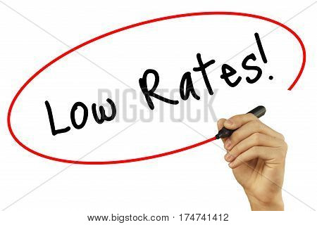 Man Hand Writing Low Rates! With Black Marker On Visual Screen. Isolated On White Background. Busine