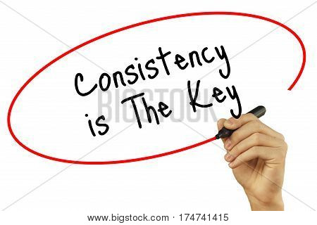 Man Hand Writing Consistency Is The Key With Black Marker On Visual Screen. Isolated On White Backgr