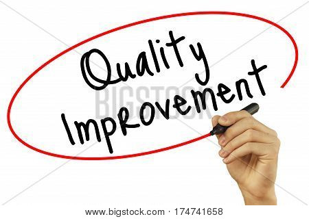 Man Hand Writing Quality Improvement With Black Marker On Visual Screen. Isolated On Background. Bus