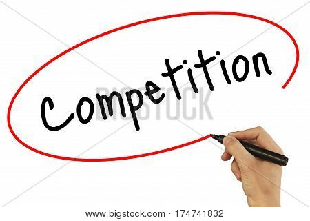 Man Hand Writing Competition With Black Marker On Visual Screen. Isolated On Background. Business, T