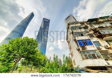 Old House Surrounded Modern Skyscrapers In Shanghai, China
