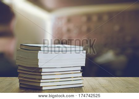 books on the table in a night club