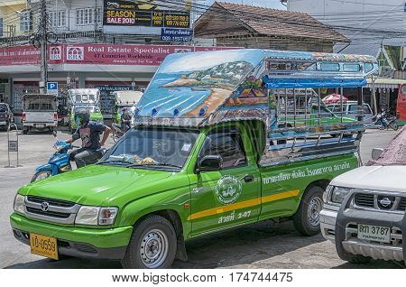 HUA HIN THAILAND - SEPTEMBER 23 2010: Songthaew pick-up truck in the center of Hua Hin. Songthaews are used as public share taxis in Thailand with set routes.