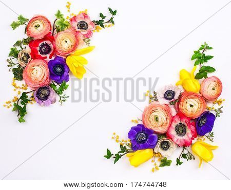 Festive flower composition made of fresh buttercups and anemone on the white background. Overhead view.
