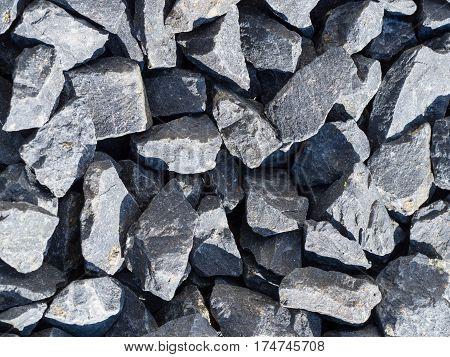 basalt stones close up an hard sunlight striplight