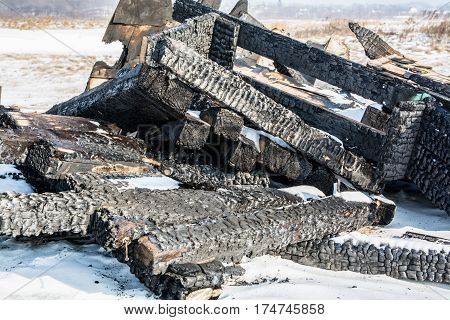 Remains of Burnt Wooden Construction. Winter Day.