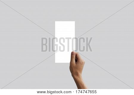 Hand holding blank flyer brochure booklet. Leaflet presentation. Pamphlet hands businessman. Man show offset paper. Sheet template. Booklet design. Display read first person.