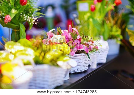 entrance into a small flower shop. Fresh flowers