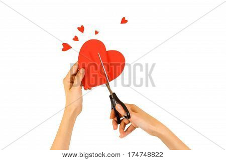 Female Hand Holding Red Valentines Card With Heart On A White Background. Сut With Scissors.