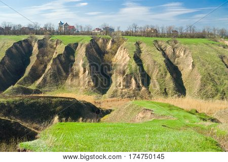 Ukranian landscape with soil erosion in early spring season.