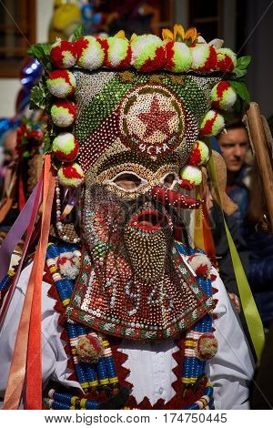 SHIROKA LAKA BULGARIA - MARCH 5: People dressed in traditional costumes called Kukeri celebrate arrival of Spring with ritual dances in Shiroka Laka Bulgaria on March 5 2017.