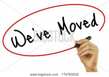 Man Hand Writing We've Moved With Black Marker On Visual Screen. Isolated On White Background. Busin