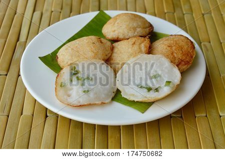 Thai sweetmeat grilled coconut milk hotcake called Kanom Krok poster