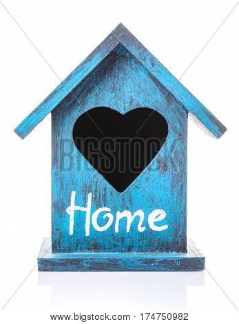 Old blue bird house on white background