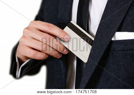 Smartly Dressed Business Man Putting A Credit Card Into His Pocket. Man In A Black Suit, White Shirt