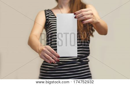 Girl Showing Blank White Flyer Brochure Booklet. Leaflet Presentation. Pamphlet Hold Hands. Woman Sh