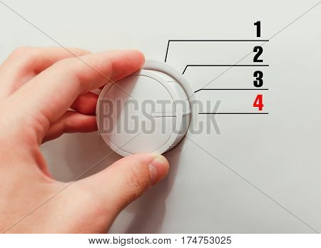 Male Hand Turns The Switch. Switches Figures. Chose The Number 4.