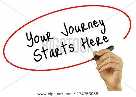 Man Hand Writing Your Journey Starts Here With Black Marker On Visual Screen. Isolated On Background