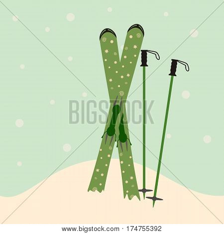 green skis and ski poles standing in snow