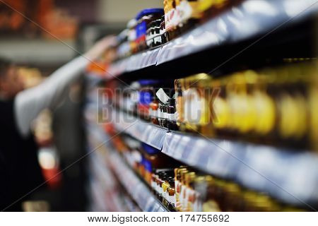 Woman shopping dairy product in grocery store.