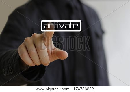 Businessman clicks on the activate button. Close up