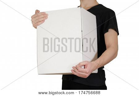The Guy In The Black Shirt Holding A Large White Box. Carries A Box On An Isolated Gray Background.