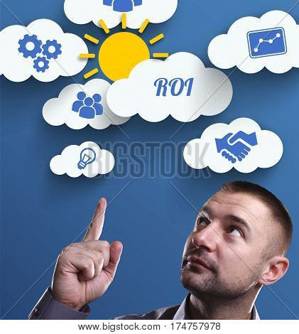 Business, Technology, Internet And Marketing. Young Businessman Thinking About: Roi