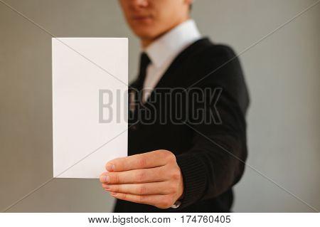 Business Man Showing Blank White Flyer Brochure Booklet. Leaflet Presentation. Pamphlet Hold Hands.
