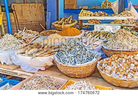 The different species of dried anchovies fish cubes shredded squids and other products of fish industry at the Manning Market in Pettah Colombo Sri Lanka.