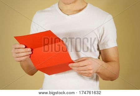 Man Reading Blank Red Flyer Brochure. Read Detailed Booklet. Leaflet Presentation. Pamphlet Hold Han