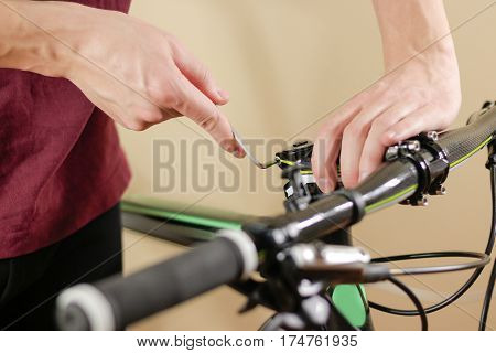 Bike Repair. Bicycle Fixing. Hex Wrench Works. Man Configures The Bike.