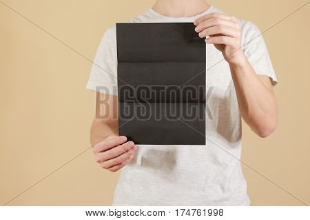 Man Showing Blank Black Flyer Brochure. Detailed Booklet. Leaflet Presentation. Pamphlet Hold Hands.