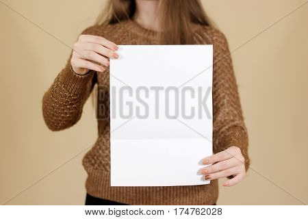 Girl Showing Blank Black Flyer Brochure. Detailed Booklet. Leaflet Presentation. Pamphlet Hold Hands
