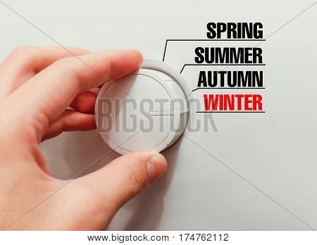 Male Hand Turns The Switch. Switches Seasons. Chose The Winter.