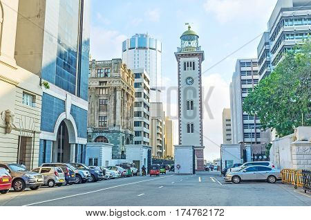 The historic building of the lighthouse nowadays located among the highrises of the Fort district and functioning as the clock tower Colombo Sri Lanka.