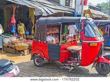 The Tuk Tuk At Market Stall