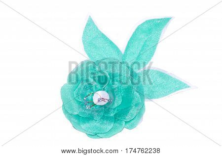 turquoise flower from fabric on a fely background a close up