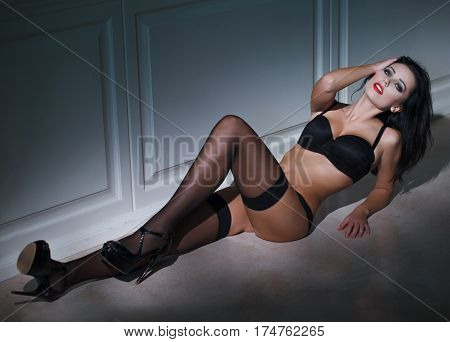 Sensual woman laying on the floor at night book cover template