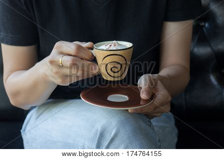Woman Hand Hold Hot Macchiato Cup stock photo
