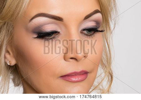 Beautiful young girl with stylish make-up near