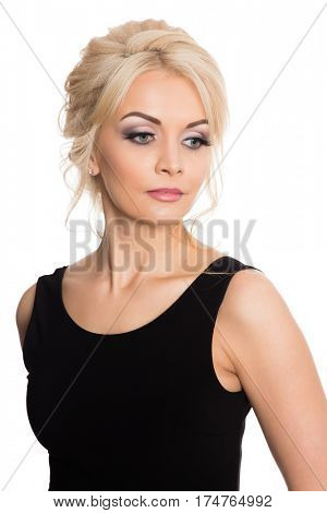 Charming young blonde in a black dress. Isolated on white.