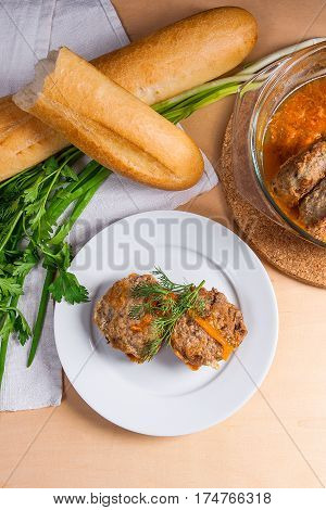 Rissole Of Pork Served On A White Plate With White Wheat Bread And Herbs - Dill, Green Onion, Parsle