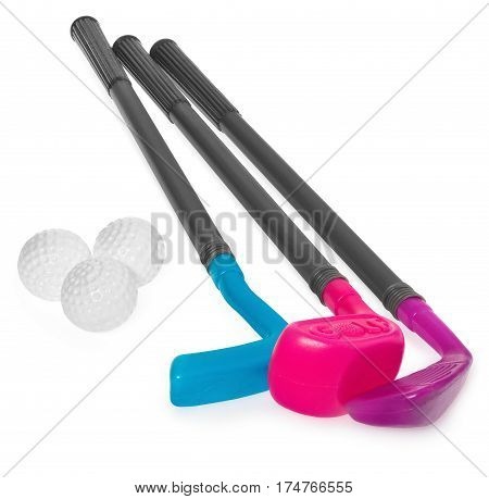 Mini golf set toy for children plastic golf stick and balls. Golf staves in the colors purple blue. Set to play isolated on white background with light shadow and reflection.